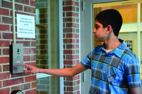 Sophomore Yash Bharatula presses the buzzer to get into the school. Administrator recently enacted a new buzzer system to enhance security. SCOTT LIU / PHOTO