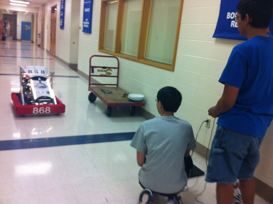Sophomore Sameer Leley toys with Tech Hound's newest robot.  The team is constantly looking to make new improvements on old projects.