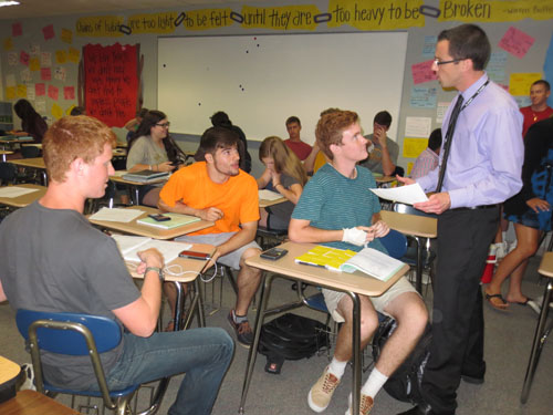 Personal finance teacher Richard Reid talks to his students about the day's lesson. Personal finance is one class this year that is no longer offered as dual credit. ALICE ZHU / PHOTO