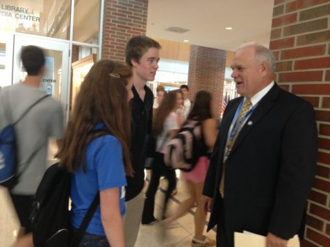 Principal John Williams talks to students in the hallway during passing period. Williams said that the administration is going to advertise the AP Capstone Program in the upcoming months. CLAUDIA HUANG / PHOTO