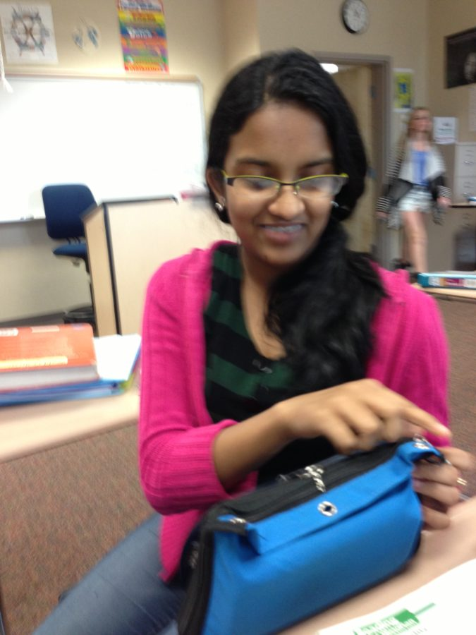 Sophomore Shriya Vinjimoor puts away her drawing utensils after practicing drawing anime for the upcoming club meeting. According to Yanying Chen, club president and senior, drawing anime is a regular club activity. SREYA VEMURI / PHOTO