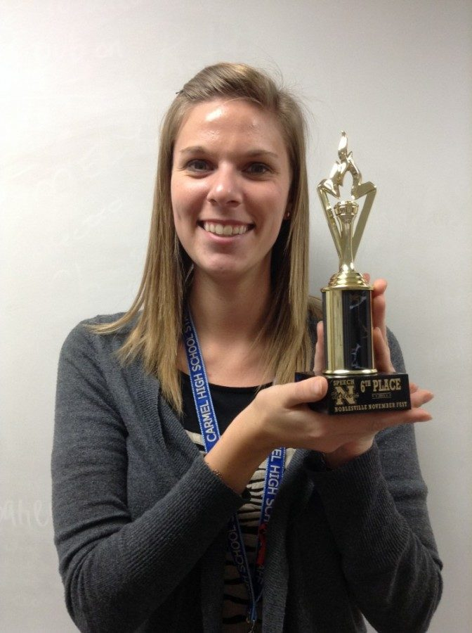 Speech team co-sponsor Anna Kaiser holds this years teams first trophy. Kaiser said speech team placed sixth overall at the Noblesville meet. LAUREN LU / PHOTO