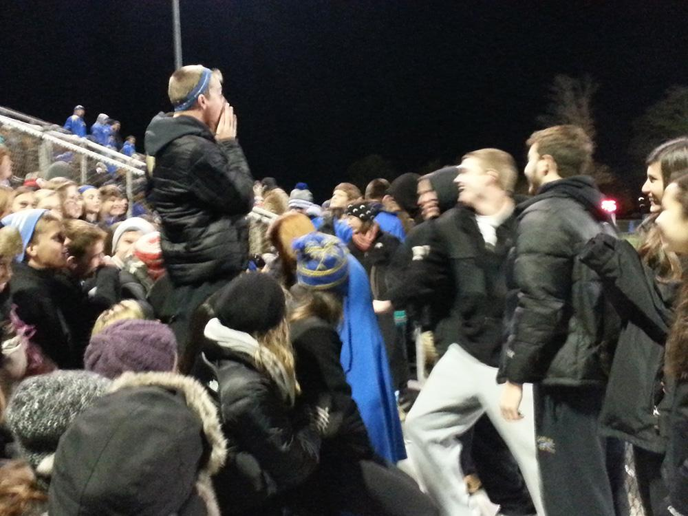 Nicky Jasin, co-president of Big Game and senior, leads a chant at a football game at Hamilton Southeastern on Oct. 25. In his role with Big Game, Jasin has injected energy into other students. JASON KLEIN / PHOTO