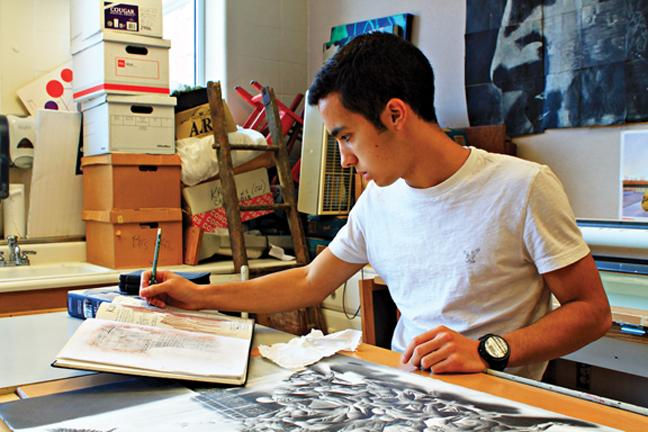 CREATION OF A MASTERPIECE: Senior Alex Mikev makes sketches for his next work. Mikev said he wants to study art in college and wants to make an impact on this school through his passion for art. CRYSTAL CHEN / PHOTO