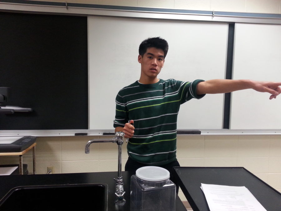 Patrick Tan, Chemistry Club president and senior, guides students and helps them prepare for the United States National Chemistry Olympiad (USNCO) national exam. Chemistry Club still offers chemistry help for students, but is focusing mainly on the national exam. JOSEPH LEE / PHOTO
