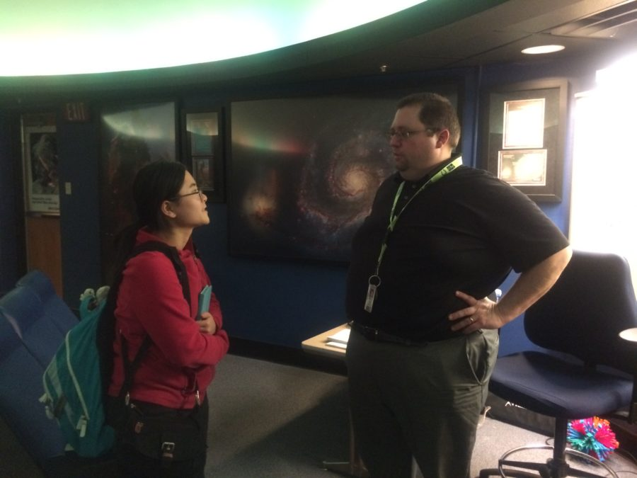 Keith Turner, Astronomy Club sponsor, talks to Yanying Chen, club president and senior, in the planetarium. Turner said he is currently planning a field trip to the Adler planetarium with Astronomy Club members. JULIE XU / PHOTO