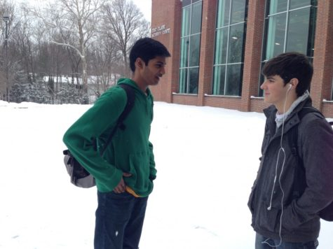 Senior Sazuth Malpeddi waits outside CHS for his bus after school. According to Malpeddi, the snow days earlier this month were a welcome extension of winter break and a safe decision. PHOTO / ERIC HE