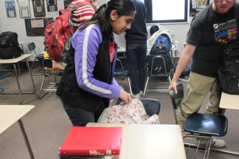 Divya Sarda, Teen Library Council (TLC) vice president and senior, packs up after class. TLC members organize events such as the annual pajama party, but they still encourage students to attend other programs like Dine on a Dime. RUSHI PATEL / PHOTO