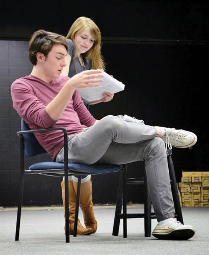 """THE GREAT REHEARSAL: Seniors Eric Stockholm and Laura Ellsworth act out the first scene of the winter theatre production """"The Great Gatsby."""" The two play the roles of Tom Buchanan and Daisy Buchanan respectively. ALICE ZHU / PHOTO"""