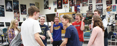 All Laughs: Members of the Comedy Sportz team practice their improv skills every week at practice. Duncan Moran (middle), junior and team member, said the  team has been practicing all school year to prepare for the competition season.