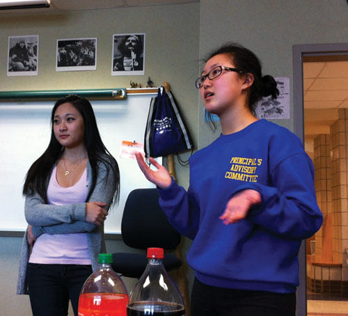 Jessica Chiang, club co-president and senior, leads a Global Giving meeting. Global Giving is partnering with Hip Hop Club for the dance jam. ANGELA WU / PHOTO