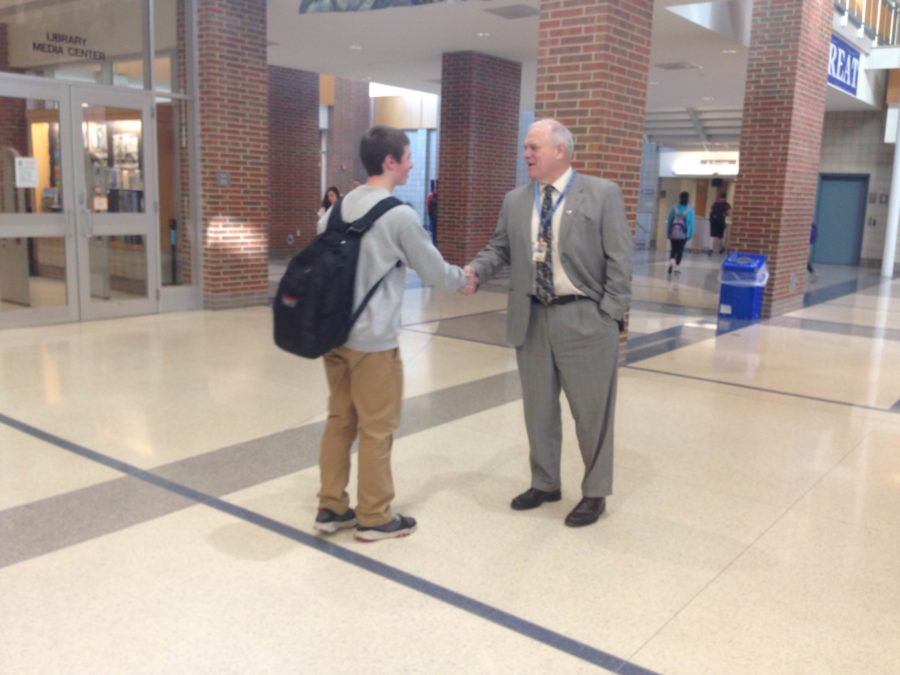 Principal John Williams talks to a student in the hallway. Williams said the school is preparing for the administration of the Organization for Economic Co-Operation and Development (OECD) Test for Schools. CLAUDIA HUANG / PHOTO