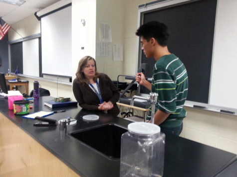 Patrick Tan, Chemistry Club president and senior, discusses his plans for upcoming events and demonstrations. Some of Chemistry Club's demonstrations range from making ice cream to their newest experiment which is freeze-dried soap bubbles. JOSEPH LEE / PHOTO