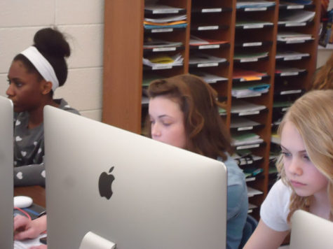 Web editor and senior Emily Brungard works on yearbook business during SRT. The final major deadline is approaching at the end of the grading period. AARON SEALS / PHOTO