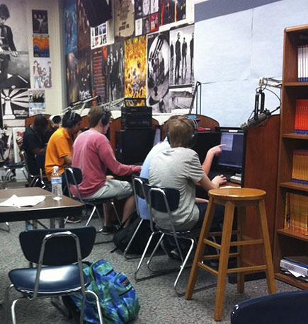 WHJE students work during SRT on radio pieces. The computers have calendars and radio pieces. ABIGAIL STACY / PHOTO