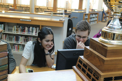 Kimaya Raje and Max Jolly, House of Books members and sophomores, work on the computer during a club meeting. Raje and Jolly participate in many House of Books Club events including World Book Night. MILES DAI / PHOTO