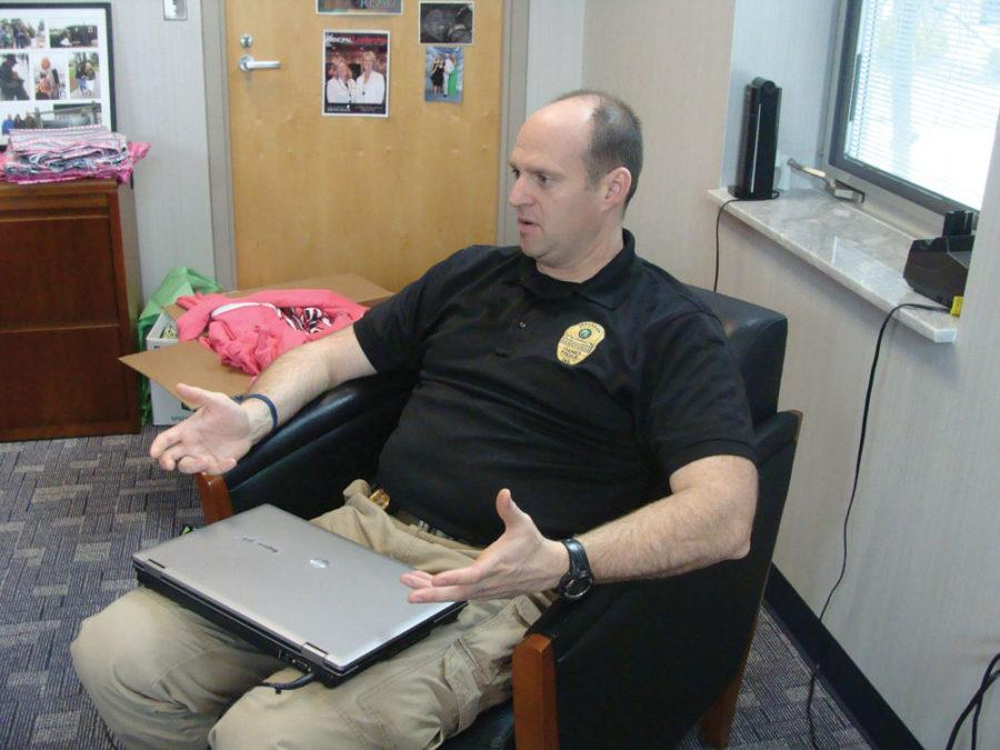 Officer Phil Hobson discusses the issues of safety brought up by the new law that allows guns in school parking lots. The bill was signed by Gov. Mike Pence on March 26 and will go into effect on July 1. SWETHA NAKSHATRI / PHOTO