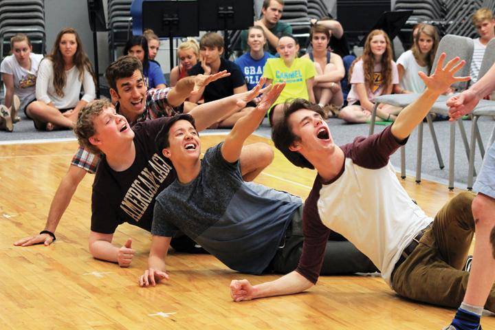 """GREASED LIGHTNING: Seniors Nicholas """"Nick"""" Dunbar, Andrew Kathan, Kyle Caress and Eric Wiegand rehearse a number for the spring musical """"Grease."""" Theater students will perform May 15, 16 and 17 at 7 p.m., and May 17 and 18 at 2 p.m. in the CHS auditorium. CRYSTAL CHEN / PHOTO"""