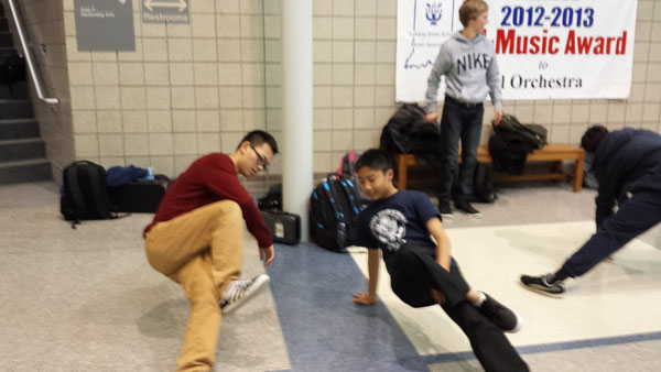 Linsu Han, club president and senior, mentors Darren Chang, club member and freshman. The club plans to have a battle on May 20. HELENA MA / PHOTO