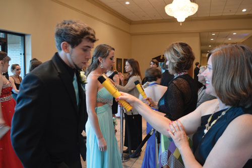Students at prom take Breathalyzer tests prior to the event, which was held May 3. The tests are taken as precaution during Homecoming and prom. ALEX YOM / PHOTO