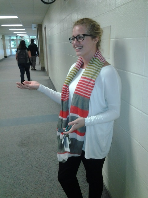 Theatre arts teacher Britta Schlicht greets passing students during her hall duty. Schlicht said she is excited for the upcoming theatre activities.
