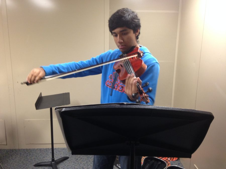 Orchestra members prepare for annual fall concert