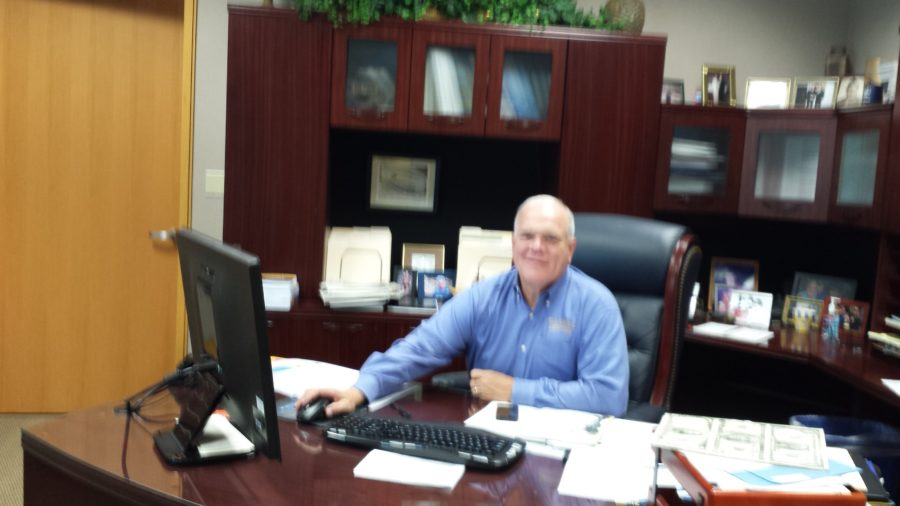 Principal John Williams works at his desk. Saturday detentions will now be given for minor offenses instead of community service working with custodial staff. HELENA MA / PHOTO
