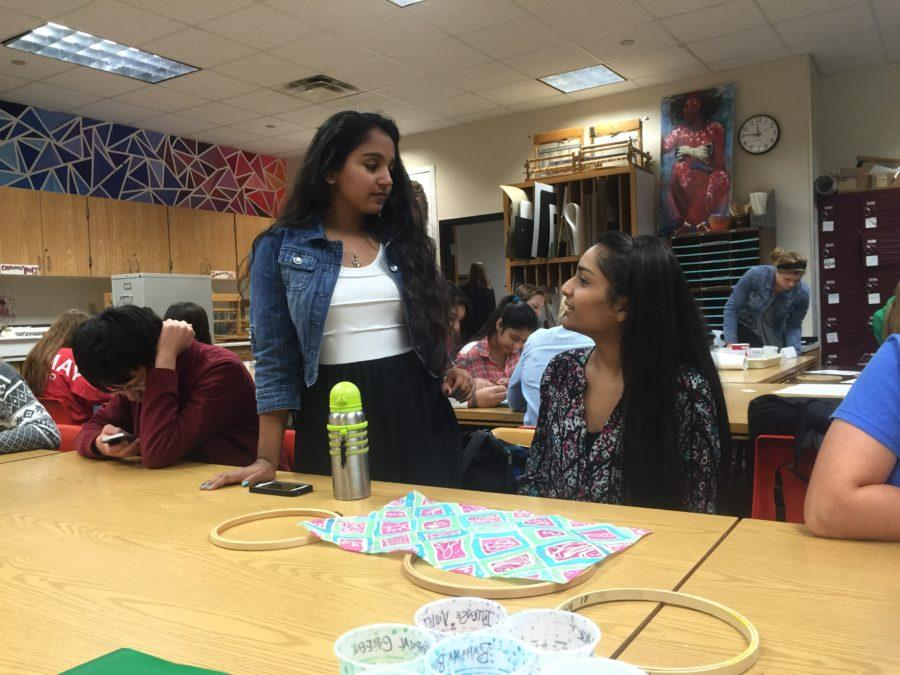 Junior Kamna Gupta talks to her friend, junior Tulsi Patel. Gupta said she did research on the effects of retinoic acid, or vitamin A, in axolotls and will present it on Nov. 7 at the Indiana Junior Academy of Science competition.