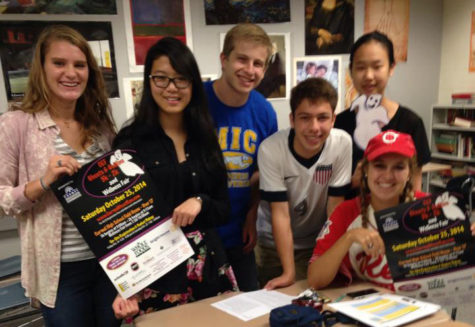 National Honor Society (NHS) committee members promote the Ghosts & Goblins 5K/2K & Wellness Fair. According to senior Joie Li (second from left), NHS has committees for public relations, awards and volunteers.  CARMEL EDUCATION FOUNDATION / SUBMITTED PHOTO
