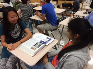 Junior Gloria Xue talks with her friends. Students like Xue have been helping the library cater to teens for many years.