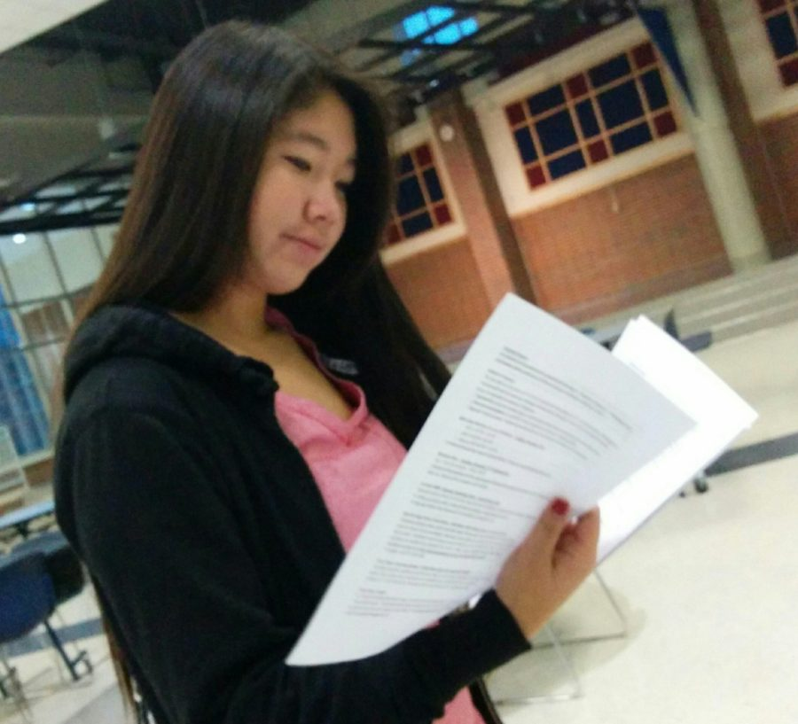 Cynthia Cahya, Key Club secretary and sophomore, reads a list of donations for the club's Teacher Appreciation. Students can donate soda, cookies and snacks for half an hour each. MELISSA YAP / PHOTO
