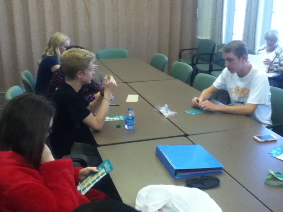At their Nov. 10 meeting, CMYC members discuss upcoming preparations for the Holiday in the Arts District event in downtown Carmel. Last year CMYC helped deliver gifts to children and set up decorations in downtown Carmel.