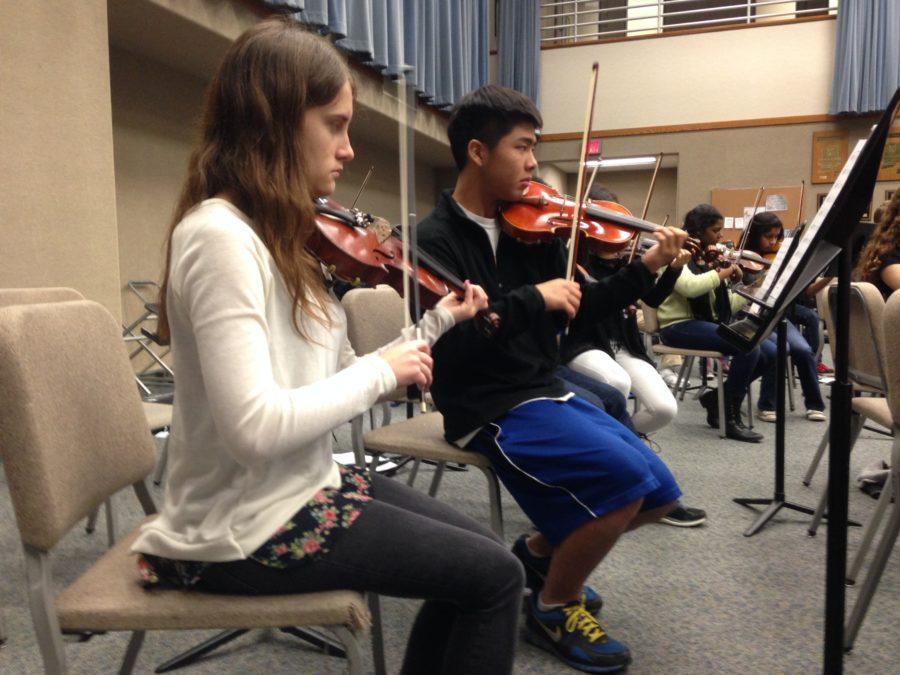 Orchestra members prepare for annual winter concert