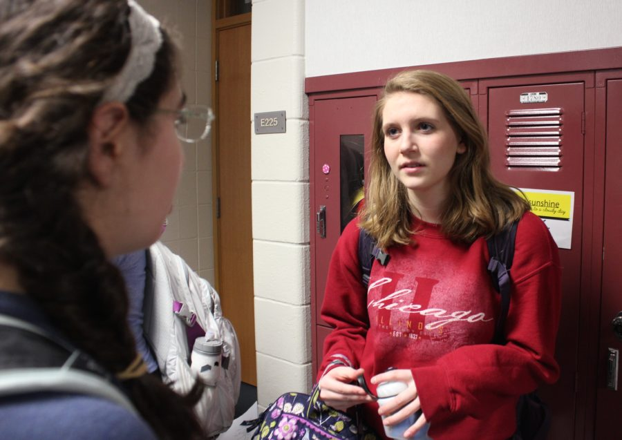 Sophomore Claire Elliott talks to her friend and fellow sophomore Anita Sayar in the hallway outside their AP European History class. Elliott, one of chemistry teacher Timothy Mylin's students, said she will miss Mylin's class second semester because he was nice and helpful.