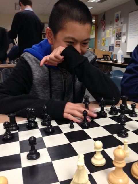 Allen+Zheng%2C+Chess+Club+member+and+freshman%2C+plays+recreationally+against+his+friends.+According+to+Zheng%2C+the+club+meets+every+Monday+after+school+to+have+fun+with+other+members+and+learn+better+strategies+for+chess.+