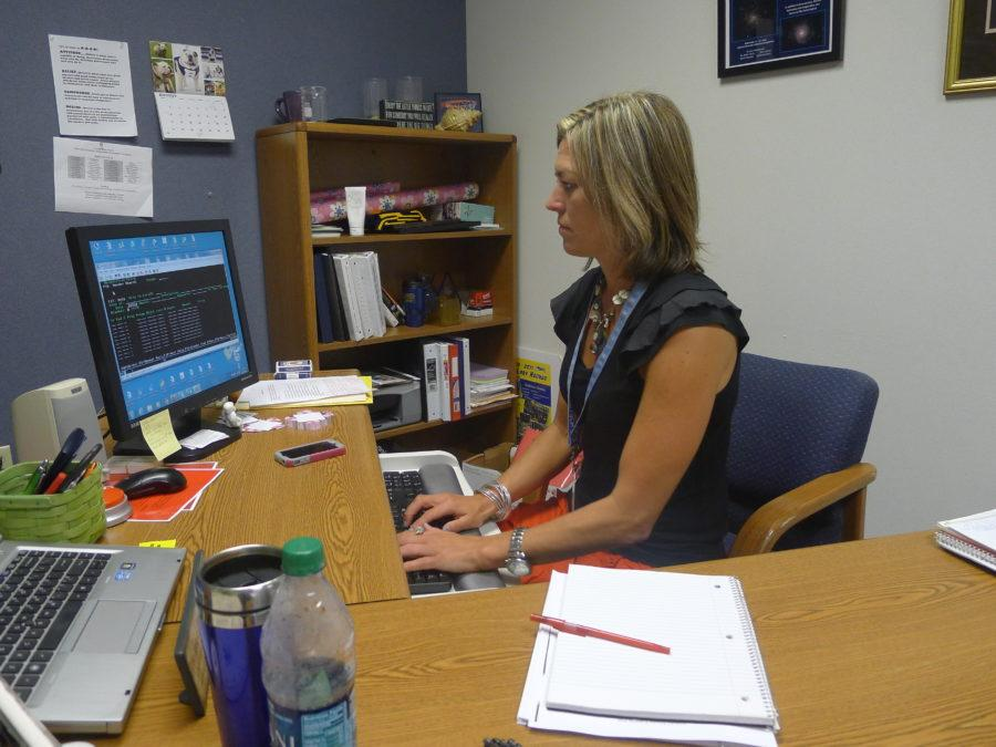 Science department chairperson Jennifer Marlow works on her computer in her office. Marlow said students who have signed up will take the Biology Olympiad exam on Feb. 11 during SRT.