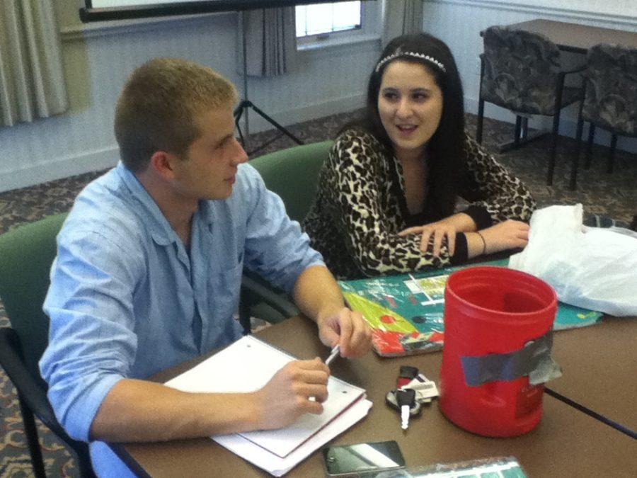 In their recent Carmel Mayor's Youth Council (CMYC) meeting, Matthew Klineman, CMYC president and senior, and Leah Zukerman, CMYC vice president of expansion and senior, plan out volunteering opportunities at the Monon Community Center. Zukerman said the Princess Ball is an event the club has volunteered at before and will be available for sign up this year as well.