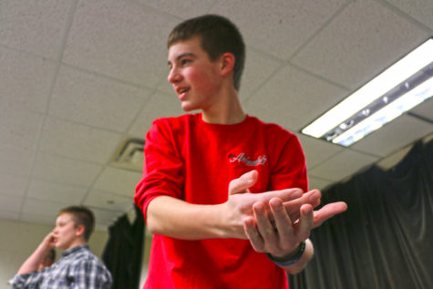 "Jacob Greene, ComedySportz member and sophomore, participates in a mock match with the rest of the team. Greene said the team members ""are prepared"" for the first match on Feb. 19. JASON KLEIN/PHOTO"