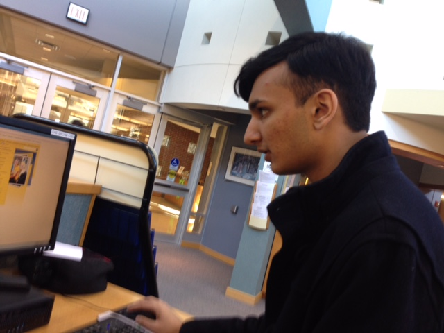 Senior Class president Krishna Pathak works on homework at the library. Pathak said the Senior Class will be inactive until prom, but also that each class has periods of activity and inactivity.