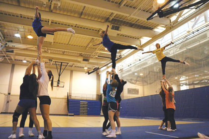 CHS cheerleading team devotes time to more than just supporting other teams