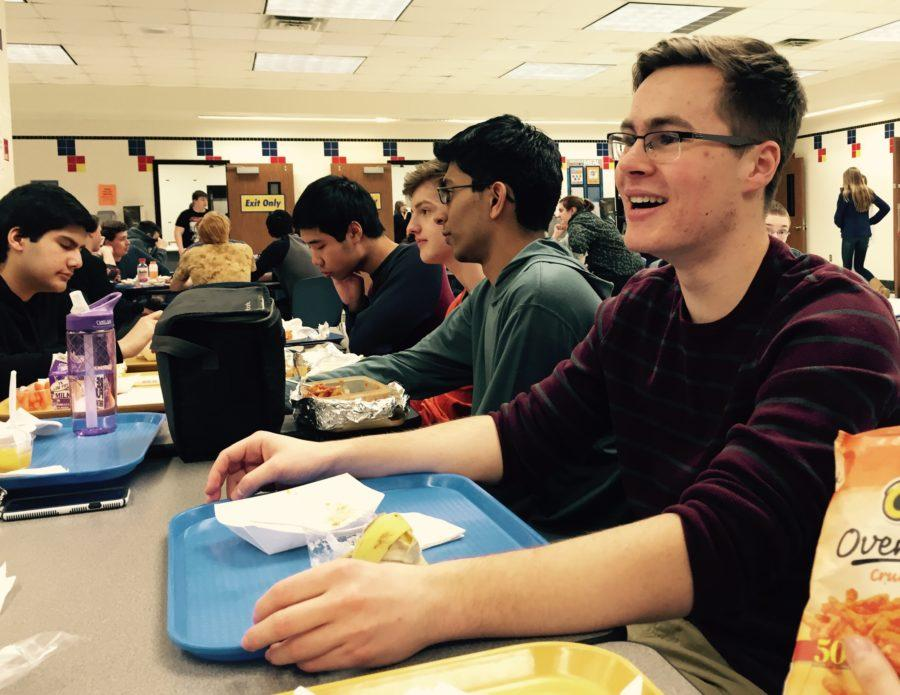 Member and junior Max Jolly (right) eats lunch in the main cafeteria. He said members are still planning on when and how to host the spring conference. JASMINE LAM/PHOTO