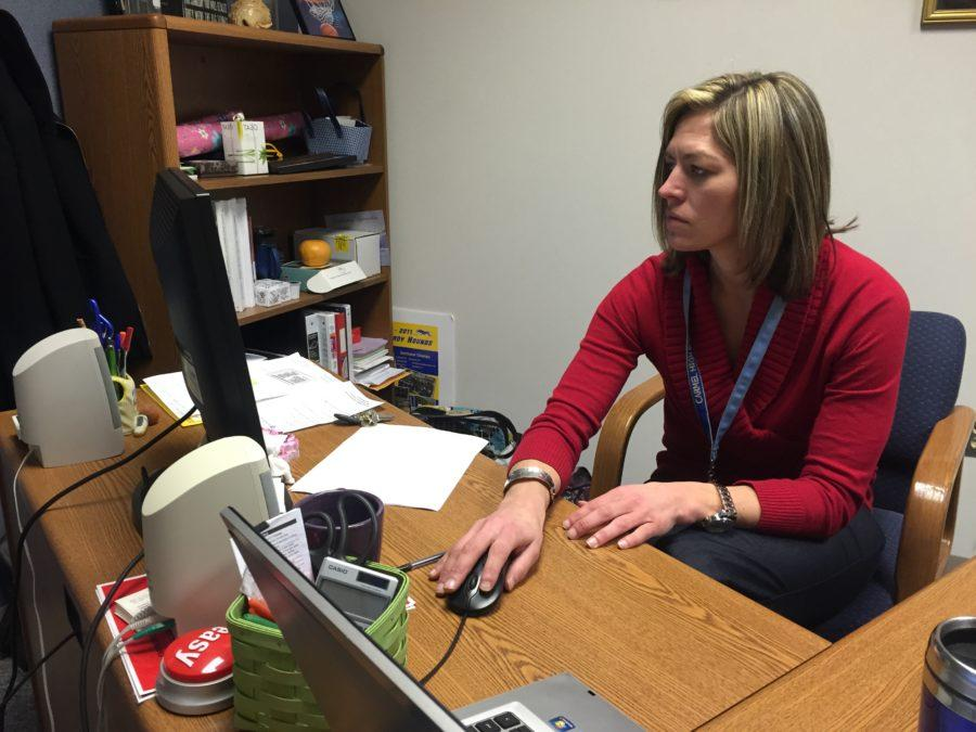 Science department chairperson Jennifer Marlow browses the Science Education Foundation of Indiana (SEFI) website. Marlow said students who are signed up for the SEFI regional science fair will present their research at Marion University on March 7.