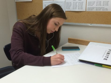 Senior Katie Popcheff works on her homework during her period as a nurses' aid. Popcheff said,
