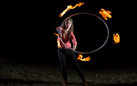 THE GIRL ON FIRE: Junior Amy Hanners performs flaming stunts