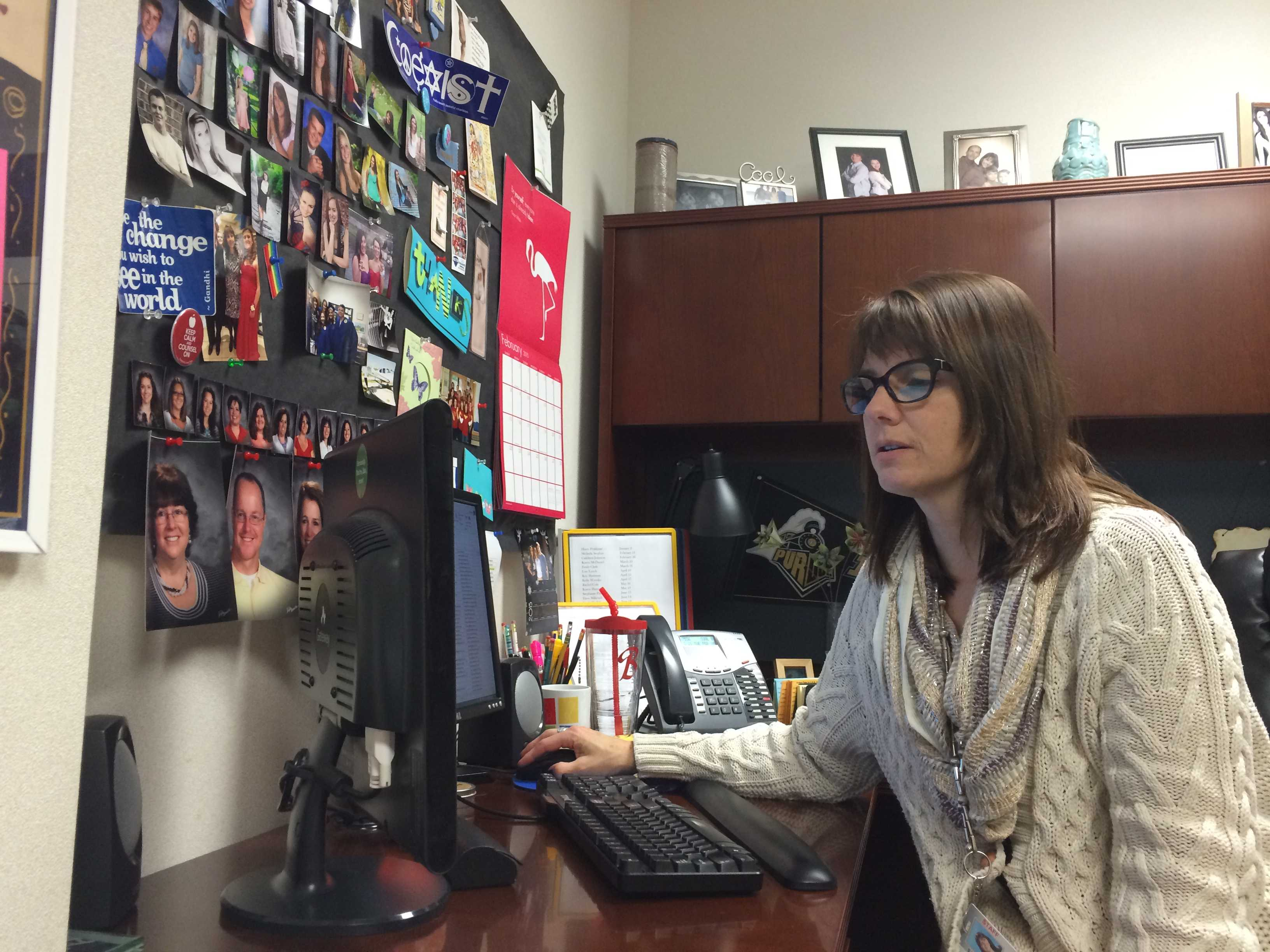 Counselor Bettina Cool searches the AP registration website. AP registration opens Feb. 13 for students.  NAOMI REIBOLD / PHOTO
