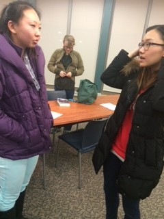 Junior Gloria Xue talks to a fellow Teen Library Council (TLC) member after a meeting. Students like Xue have played an integral role in planning for the event.