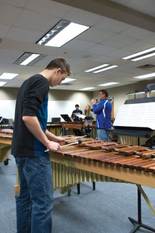 Senior Aaron McGhiey plays the marimba when practicing for the 2015 percussion concert as a freshman. McGhiey said the concert is a great opportunity for older percussionists to work with younger students.