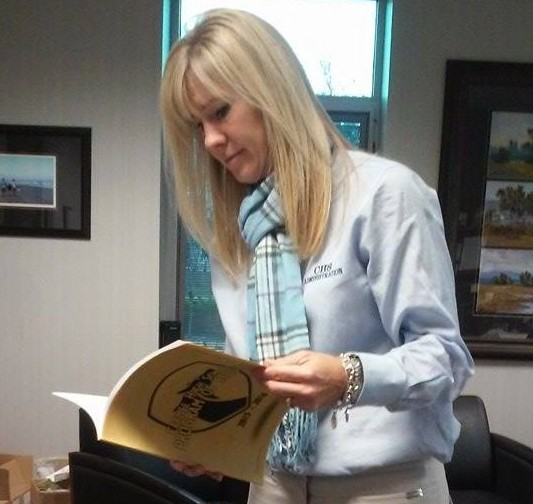 Assistant Principal Amy Skeens-Benton flips through the 2014–2015 Program of Studies. Skeens-Benton said most freshmen have already scheduled their classes for sophomore year, and eighth graders are ready to decide which clubs they are interested in for freshman year.