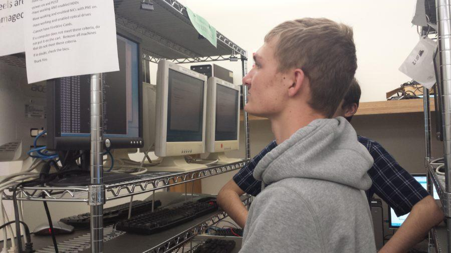 Ben Krueger, vice president and senior, installs Windows 7 on a used computer. According to Krueger, this step is part of the refurbishing process.