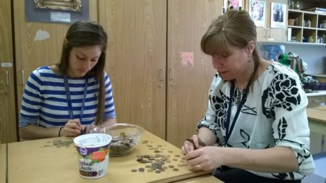 "During Art Club's March 18 meeting, student teacher Lauren Saunders and Art Club sponsor Jennifer Bubp scrape epoxy glue off of pennies. Bubp said the art department would use the ""recovered"" pennies to help fund the Scholastic Art Awards trip to New York this semester. JESSICA MO/PHOTO"